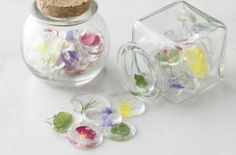 Inspired by traditional Japanese marbles, which are basically flattened spherical ones, Sweets & Deli's crystallized sugar drops replace the glass version's central swirls of color with dainty edible petals or herbs.