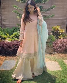 Buy Peach And Antique White Color Sharara Suit by Akanksha Singh at Fresh Look Fashion Indian Fashion Dresses, Indian Gowns Dresses, Dress Indian Style, Fashion Outfits, Pakistani Formal Dresses, Pakistani Dress Design, Pakistani Outfits, Pakistani Couture, Sharara Designs
