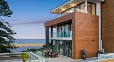 How fabulous is his house 😍 You too will love our glass balustrades as much as we do after seeing all these amazing benefits: • Safety guaranteed • Durability • Stylish addition to a modern house • Increase a property's curb appeal • Keep your view without compromising on safety • Corrosion-proof aluminium and stainless steel framing available (great for coastal homes) #bettabalustrades #balustrades #landscaping #homeinspiration #centralcoastnsw #newcastle #sydney Glass Balustrade, Central Coast, Coastal Homes, Newcastle, Betta, Curb Appeal, Mansions, Landscape, House Styles