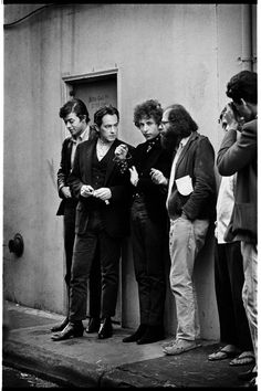 The Poets (Allen Ginsberg, Robbie Robertson, Michael McClure, and Bob Dylan) in the alley next to City Lights Bookstore, San Francisco, 1965