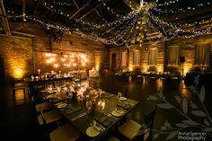 Anna and Spencer Photography, Atlanta Wedding Photographers. Wedding Reception at King Plow in West Midtown Atlanta. Farm tables, Edison bulbs, Christmas lights, & Lanterns in an industrial setting.