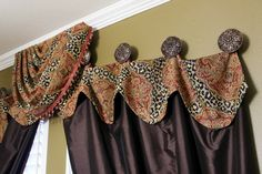 Animal Print & Chocolate Guest Room - Topped with ornate hardware, this drapery has a wild side that can't be beat. From the animal and medallion print detail to the rich chocolate fabric, it's a lavish element that really complements the entire space. Photo Credit: Samantha Day - Brandi Renee Designs, LLC - www.brandireneedesigns.com