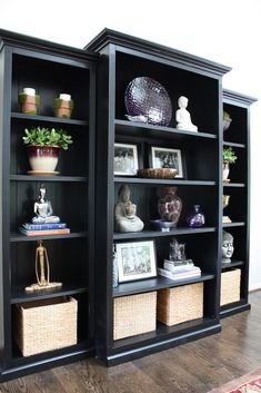 Trim three inexpensive bookcases with mouldings and paint them black... they look great!