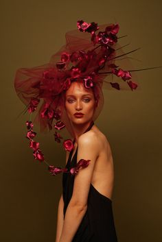 Petal Shower   Awon Golding Millinery   Floral Decay collection, Autumn-Winter 2015   Elegant statement veil. Burgundy tulle, pink metallic silk petals, black ostrich quills and hand-cut black pheasant sword veil feature on a leather base and ribbon covered headband