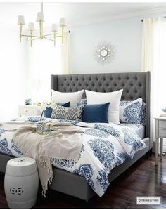 Gorgeous Blue And White Bedroom Featuring Bedding Paired With Global Inspired Textiles Grey Upholstered Bed Br Accents Lighting