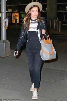 Olivia Wilde wearing Balenciaga Leather Jacket, Graf & Lantz Frankie Tote, Converse Chuck Taylor All Star Core Ox Sneakers, Big Star Jordan Overalls in Park and Rolla's Stripe Top
