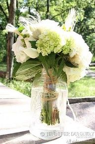 Sample of flowers done in mason jar with whisky feathers