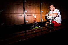Stanislas Wawrinka poses with the Norman Brookes Challenge Cup in the men's locker room, 26 January 2014. - Ben Solomon/Tennis Australia