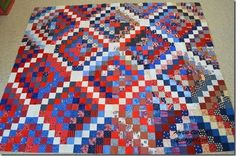 scrappy trip along Quilts of Valor style - with white down the center of each block