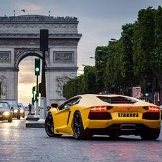 Lambo Aventador cruising in Paris with the backdrop of the 'Arc De Triomphe' Click for more #Paris #inspiration
