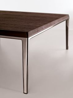 Table Michel B & B Italia combines the raw smoked oak of the table with a smooth metal base. www.bebitalia.it