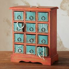 """DOZEN DRAWER JEWELRY BUREAU--Twelve drawers crafted of reclaimed iron sheeting cradle accessories neatly out of sight. A rustic paint job recalls the iron's industrial origins. Handcrafted Sundance exclusive. 11""""W x 6""""D x 14-1/2""""H."""