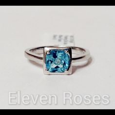 Sterling Silver Blue Topaz Floating Diamond Ring Blue Topaz Floating Diamond Ring - 925 Sterling Silver - Square VG/VS Blue Topaz Gemstone Measures Approx 6 X 6mm (Approx 2 Ct) - Inset EF/VVS Diamond Measures Approx .01 Ct  - US Size 6.5 / NWT (more than one available) NWT Retail Jewelry Rings