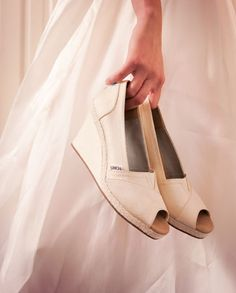 I suck at wearing high heels but these look comfy and support a good cause. TOMS wedding shoes