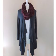 ❗️LAST ONE❗️🎉HP!!🎉Dark Olive Green Cardigan Solid drape ribbed hi-lo open-front olive green cardigan.  Modeling size S.  Didn't come with tags.  Price firm unless bundled.                                                   ▪️75.5% Rayon 21.3% Polyester 3.2% Spandex ▪️Hand wash.                                                         ▪️Made in the USA🇺🇸.                                          🚫Trades Boutique Sweaters Cardigans