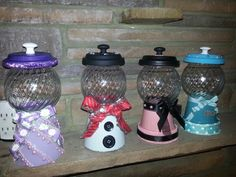 Lavendar, snowman, pink/black and teal gumball machines made by Nancy Sinatra 2013.