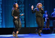 Erica Atkins-Campbell and Tina Atkins-Campbell of the gospel duo Mary Mary perform at the Super Bowl Gospel Celebration 2014.