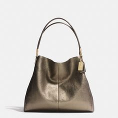 And here's the Madison Small Phoebe Shoulder Bag to match all my favorite wristlet's  In Metallic Leather from Coach! This I'll probably never own but it's nice to wish for!