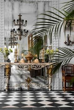 I have a weakness for black & white checkered floors...the chandelier, console & palm with those walls add to the perfection.