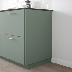 Choose a cover panel in the same finish as your door for a uniform expression, or mix and match to suit your taste. Plastic Foil, Ikea Family, Green Kitchen, Green And Grey, Filing Cabinet, Home Kitchens, Cleaning Wipes, Kitchen Design, Furniture