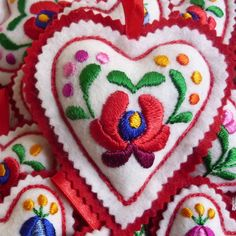 Hand embroidered filled felt heart with hanging tab Red felt backing 11cm long These hearts are embroidered by women from a folk art co- operative in