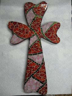 red and pink stained glass mosaic cross
