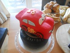 Lightening McQueen and tyre birthday cake - clotted cream tyre and chocolate car