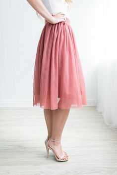 The perfect tulle midi skirt is here. Comes in mauve, dusty mustard and black. Runs true to size Available in multiple colors Stretchy waistband