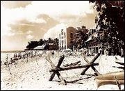 Barbed wire ringed Waikiki Beach during World War II.