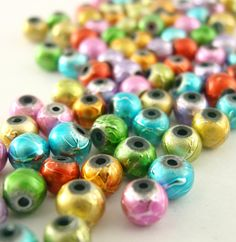 120 Textured Colorful Beads with Hollow Core - 4mm. $9.00, via Etsy.