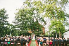 The Merrimon Wynne House   We love the bright red petals that add a little pop to the aisle! // Autumn Harrison Photography