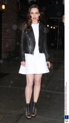 Emilia Clarke.  White dress x Leather jacket.