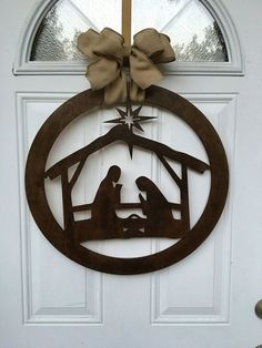 This nativity scene door hanger is simply beautiful! This sign is made from in wood. This sign is stained and a burlap bow is added for easy hanging. We also offer this in white. If you have a special request message us and we willVinyl Nativity Scen Outdoor Nativity Scene, Diy Nativity, Christmas Nativity Scene, Christmas Door, Outdoor Christmas, Christmas Time, Christmas Wreaths, Christmas Decorations, Xmas