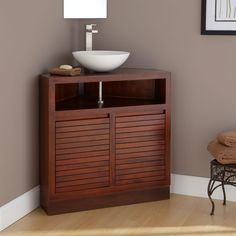 Photo Gallery On Website Bathroom white bowl sink placed on the triangle brown wooden vanity with storage placed on