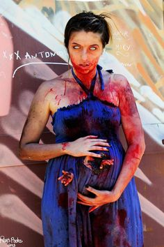 This actually isn't a list of the 15 best pregnant zombie costumes. This is a list of the 14 best pregnant zombie costumes, and one fat dude with a weird baby growing out of… Zombie Halloween Party, Halloween 2015, Couple Halloween, Halloween Customs, Halloween Makeup, Happy Halloween, Pregnancy Costumes, Pregnant Halloween Costumes, Scary Halloween Costumes