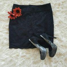 "Banana Republic Skirt Black, elegant, lace skirt.  MATERIAL:  Shell- 56% Nylon, 44% Rayon  Lining- 100% polyester  MEASURES :  Waist 15.5"" (flat)  Hips19"" (flat)  Length 18"" Banana Republic Skirts Mini"