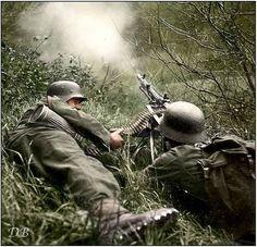 Two Gebirgsjägers (mountain infantry) manning an MG-34 machine gun