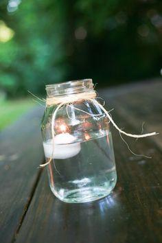 mason jar centerpiece  .. could even colour the water.....