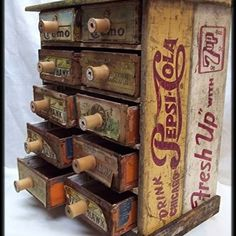 Soda pop boxes...cigar box drawers and spools for pulls equals awesome!!