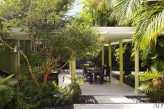 Landscape architect Raymond Jungles enveloped the terraces in palms, lignum vitae, gardenias, and orchids.