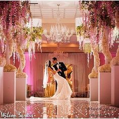 Stunning wedding! Gorgeous couple! Floral design by @vonre_events and @topthattable who created the majestic lighting, drape and overall pink vibe. @chanel_sarkis and @sarkisphoto