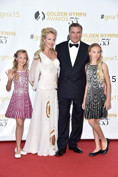 Prince Charles of Bourbon-Two Sicilies and his wife Princess Camilla of Bourbon-Two Sicilies pose with their daughters Princess Maria Chiara and Princess Maria Carolina (R) during the closing ceremony of the 55th Monte-Carlo Television Festival on June 18, 2015, in Monaco.