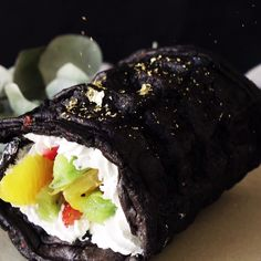 This colorful, chocolatey and fruity dessert waffle looks just like a giant sushi roll.