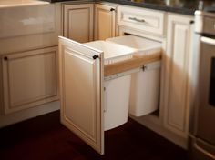 A wastebasket pullout features hidden bag storage and accommodates one trash and one recycling bin.