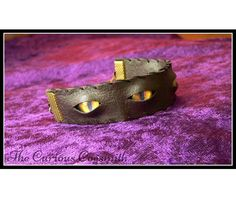 faux_leather_and_eyes_cuff_bracelet $17