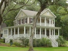 Wrap around porches are my favorite.....i have always wanted to live in south and have a beautiful house like this