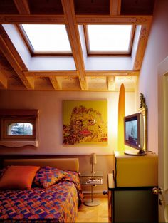 Two large VELUX roof windows transformed this dark attic space into a cosy top-floor bedroom. Placed above the bed, the windows bring life and light to the space – and offer a great view on a starry night. Night Window, Mountain City, Roof Window, Inside Job, Attic Spaces, Great View, Blinds, Loft, Windows