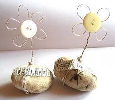 (::)  Just too cute!   Button flowers wired on rocks.  Cute as a paperweight.