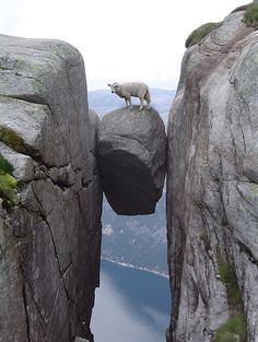 Wedged between the walls of a mountain crevice in Norway is a rock called Kjeragbolten. The rock is often stood on by tourists for a crafty photograph whilst attempting not to look down at the 3000ft+ drop.