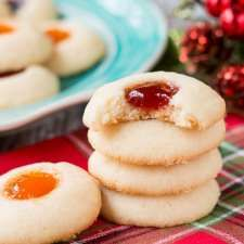 Jam Thumbprint Cookies - Little Sweet Baker This classic holiday cookie is buttery and chewy with a delicious pocket filled with jam. Best Thumbprint Cookies, Raspberry Thumbprint Cookies, Jam Cookies, Yummy Cookies, Gluten Free Gingerbread, Holiday Cookie Recipes, Holiday Cookies, Chocolate Chip Muffins, Baking